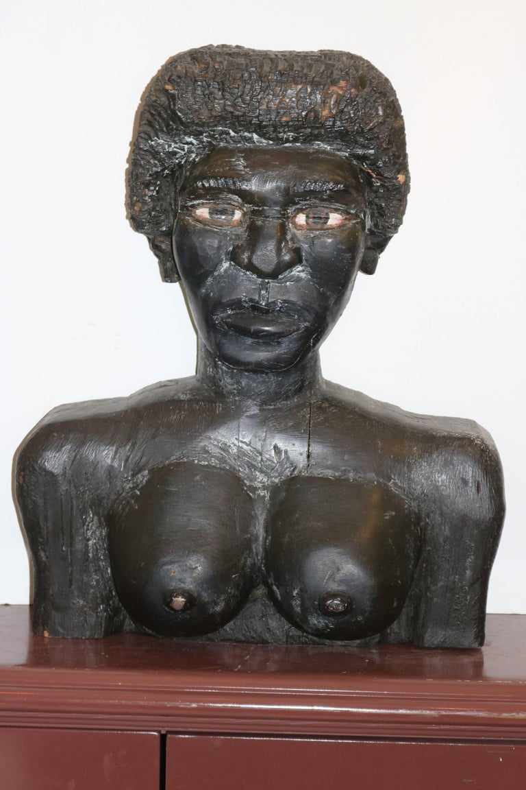 A mesmerizing Very Large Powerful poignant pair of Outsider American Folk Art black male and female wood hand carved busts sculpture. Most extraordinary that we have ever seen. To view them is to be impressed with the naive self taught skillful hand