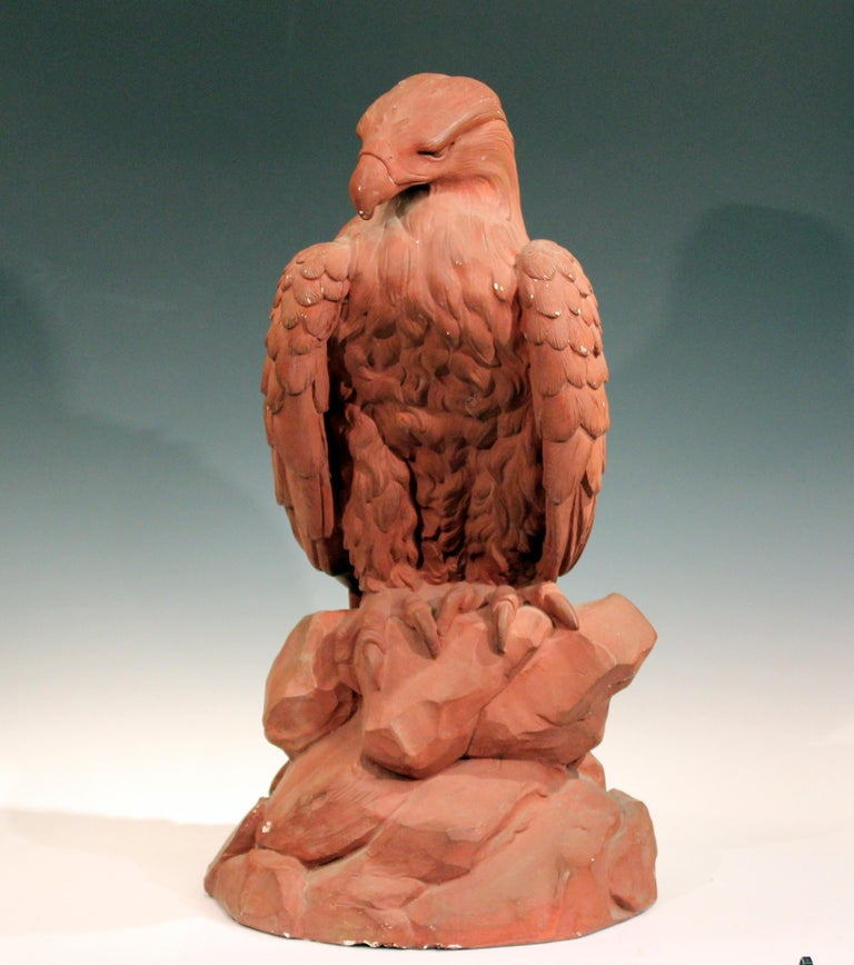 Large painted plaster eagle sculpture, circa mid-20th century. Excellent rendering of the majestic bird perched on a rock outcrop with crisp detail. Signed at lower portion. Measures: 30