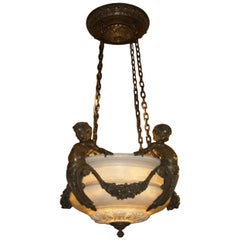 A superb gilt bronze chandelier with alabaster dome and shades.