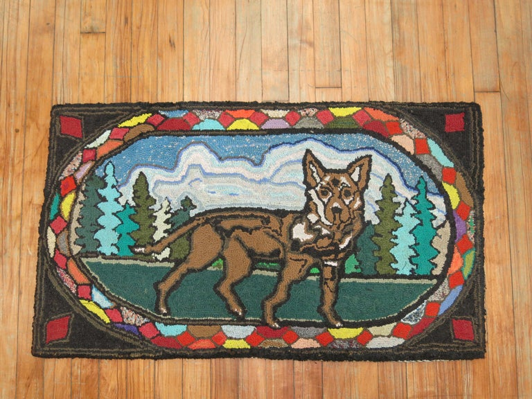 A handmade decorative American hooked rug from the early part of the 20th century. Condition is really nice. No stains, no tears, has been professionally cleaned. Backed with blue fabric.