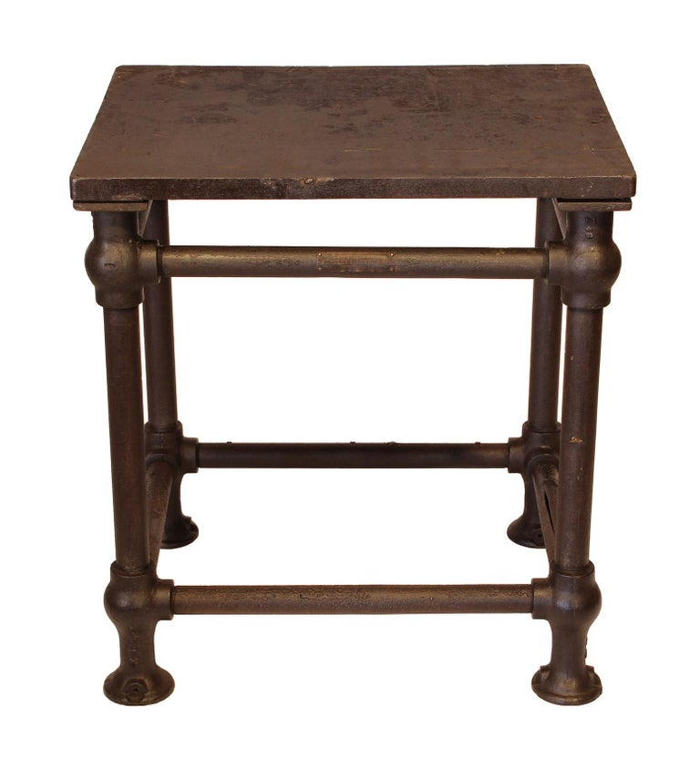 Original American made cast iron and steel industrial stationary printers letterpress table. This 'Turtle Table' was used in the printmaking industry for making up printing forms. Features 11/8