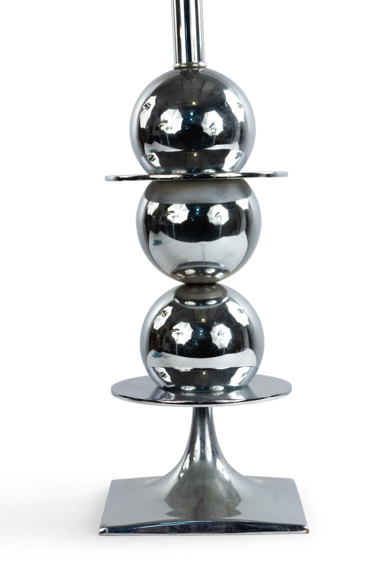 American midcentury chrome table lamp composed of discs and spheres on a square base.
