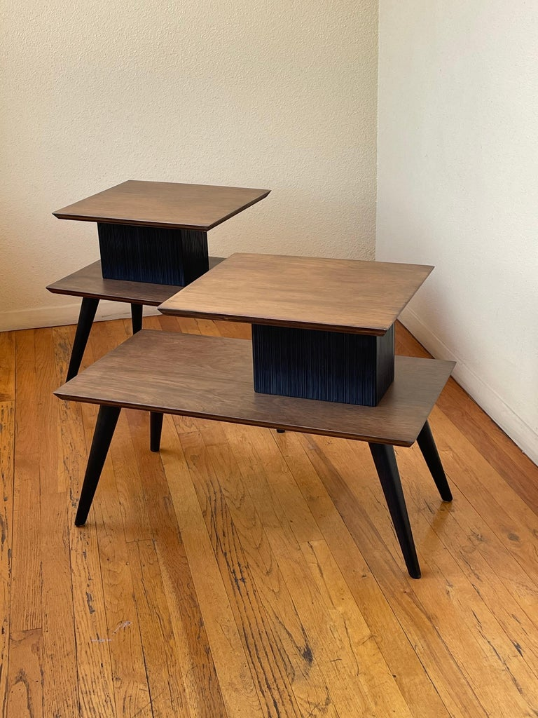 Very rare of atomic age step end tables designed by Paul Frankl, circa 1950's in walnut finish with black lacquer accents, freshly refinished very rare set hard to find.