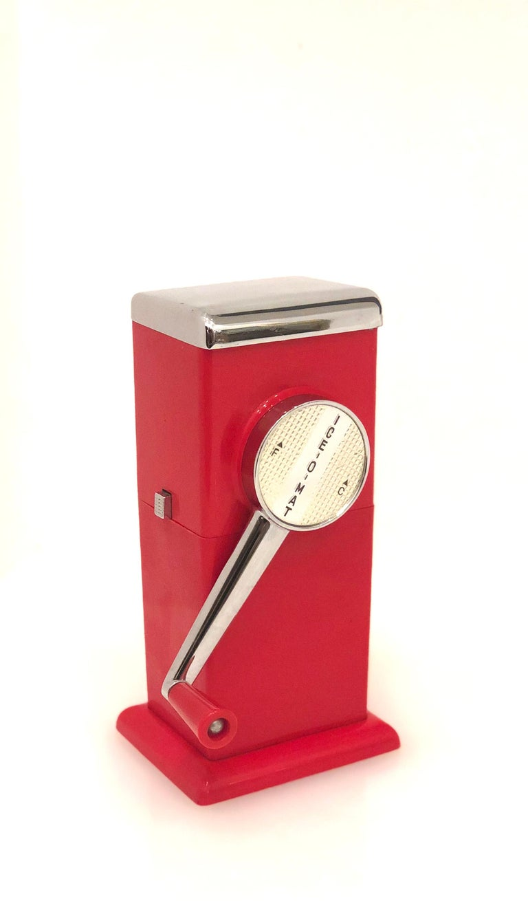 A beautiful design Industrial Atomic age, in red fire engine, circa 1950s with wall attachment if its desire to install, the bottom its a plastic catcher and the top its enameled finish with chrome, you can use right or left for finer or coarse, the