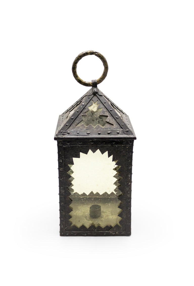 American mission square wrought iron hand lantern with amber glass inset into sawtooth design framed panels with brass ring top.