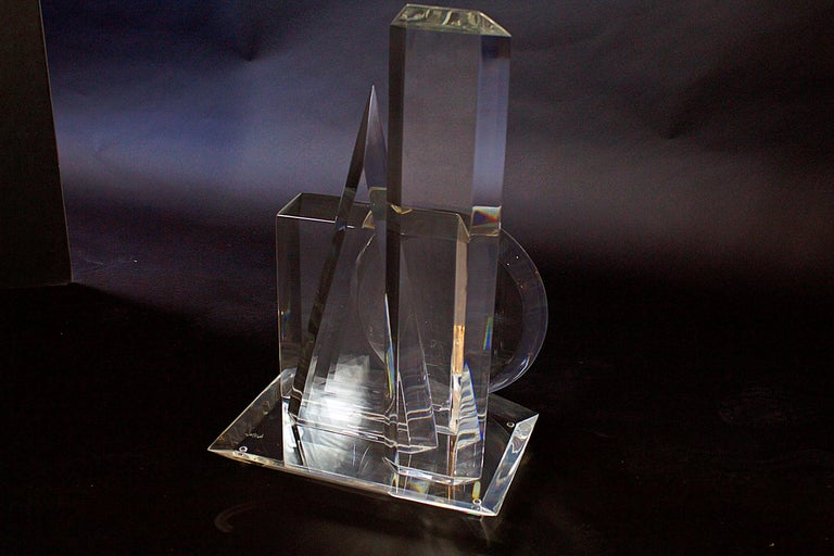 A wonderfully dimensional sculpture by Van Teal in their signature Lucite. The piece consists of the 4 basic geometrical shapes, rectangle, square, circle and triangle, all beautifully composed atop a Lucite base. This dramatic piece consists of