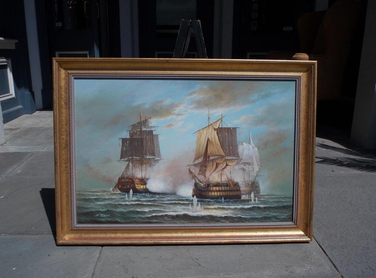 American Nautical oil on canvas with three battling ships at sea in the original gilt frame, 20th century. Signed by Artist N. Thomas.