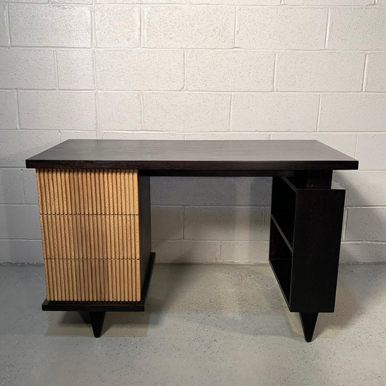 Mid-Century Modern, desk or vanity by American of Martinsville features a faux bamboo motif on it's 3 drawers framed in black lacquer with open display shelves on the opposite side.