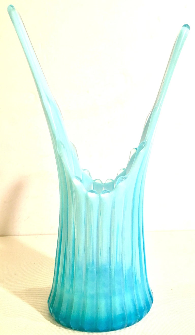 Mid-Century American slag glass vase in opalescent sky blue. Features a fluted body stile with cased white detail.