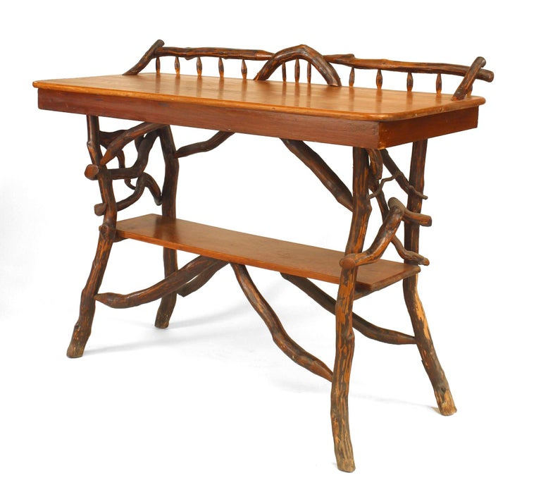 American Rustic Adirondack serving table of twig and root construction with gallery above a rectangular pine top and under-tier (attributed to Ben Davis, circa 1920, North Carolina).