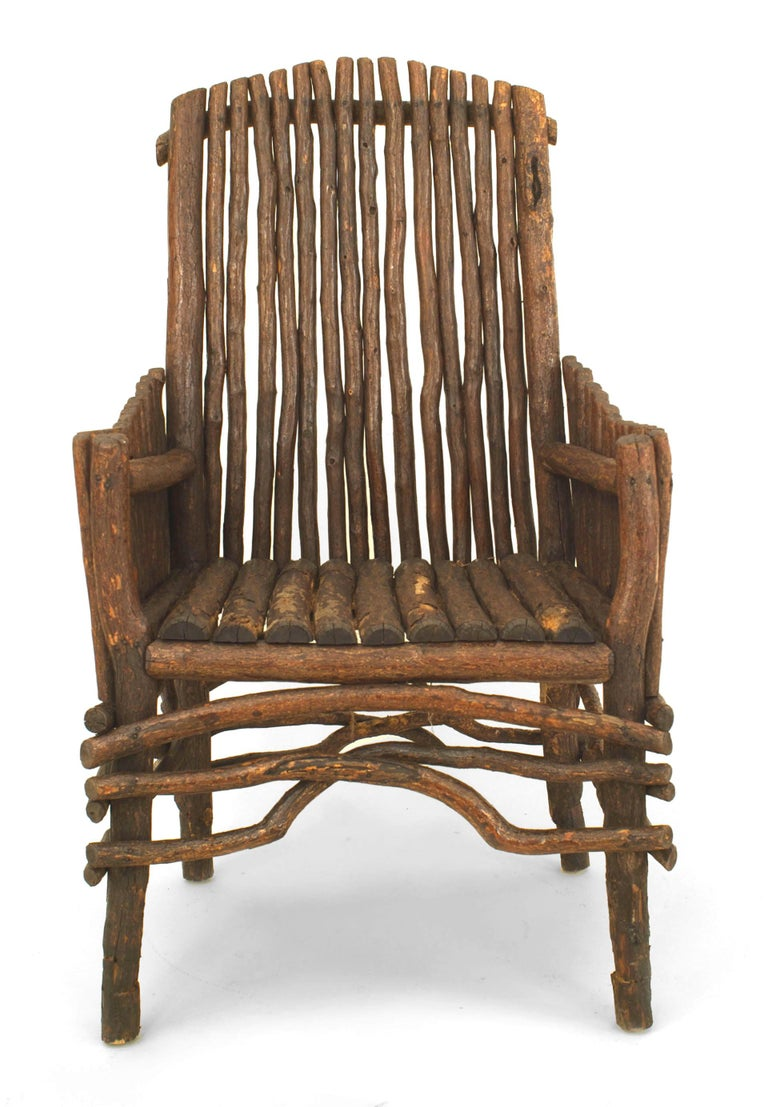 American rustic Adirondack, first quarter of the 20th century slat twig design armchair with an arch form high back and solid slat twig sides with a root stretcher.
