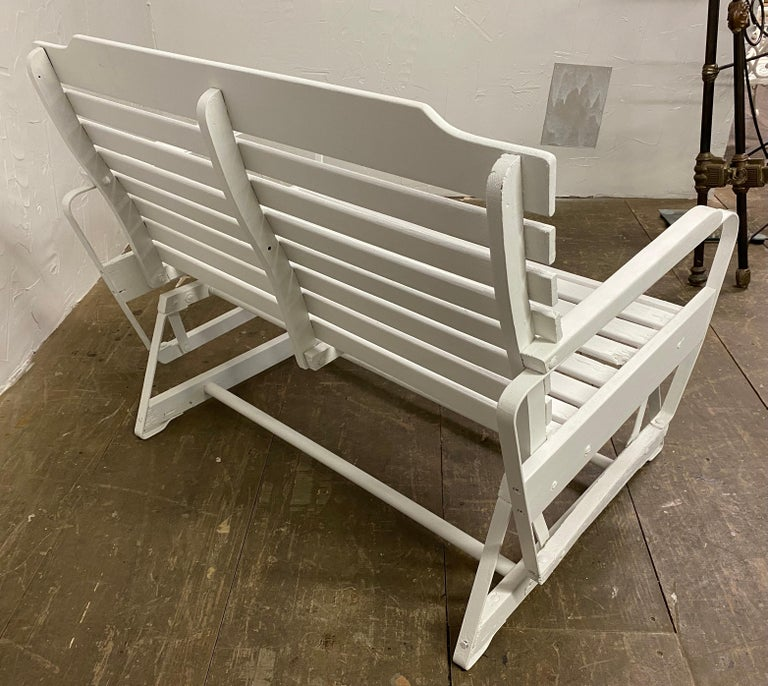 A wonderful outdoor patio glider freshly painted white. Lean back and relax on your porch, patio or garden and enjoy the smooth gliding rocking motion of this loveseat.