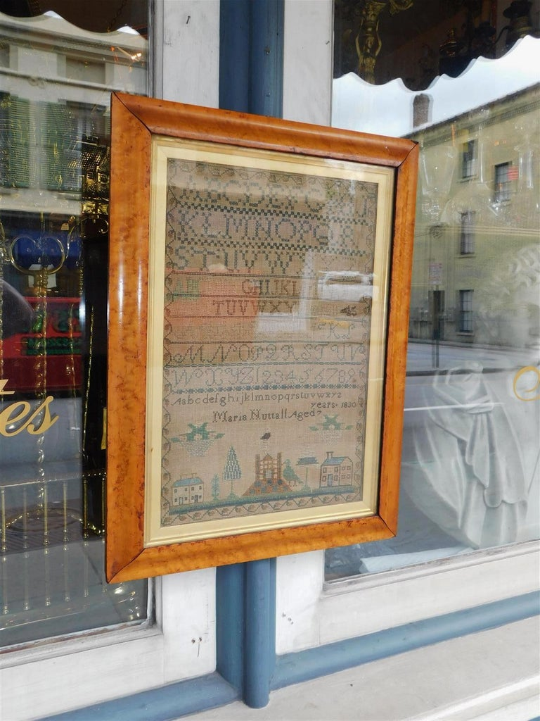 American sampler under glass with the original gilt Birdseye maple frame, Early 19th Century. Alphabet and Numerals. Signed by maker Maria Nuttall Age 7.