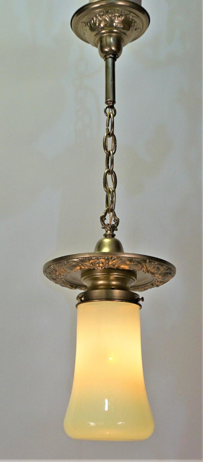 American brass chandelier with opaline-vaseline glass pendant or chandelier.  Glass measurement: 9
