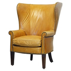 American Vintage Leather Covered and Nail Head Trimmed Wing Back Chair, 20th C.