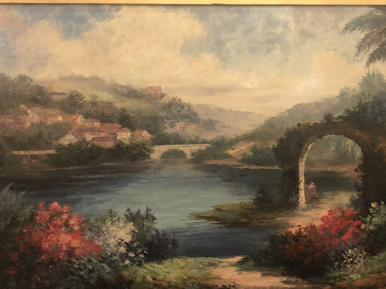 An elegant oil on canvas landscape painting featuring a lake view in a paradisiac environment. The painting is finely framed in custom giltwood frame. A wonderful addition to any living space or office. The painting is signed by artist, P. Paul.