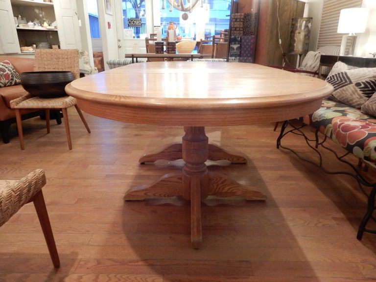 A two column solid white oak Americana dining room table, the table measures 82 inches with both leaves in, without the leaves the length is 60 inches (closed) and oval in shape. All beautifully hand crafted and good condition. Seats 8 comfortably.
