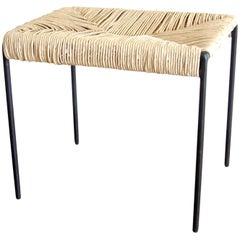 Americano woven cane and blackened steel ottoman stool