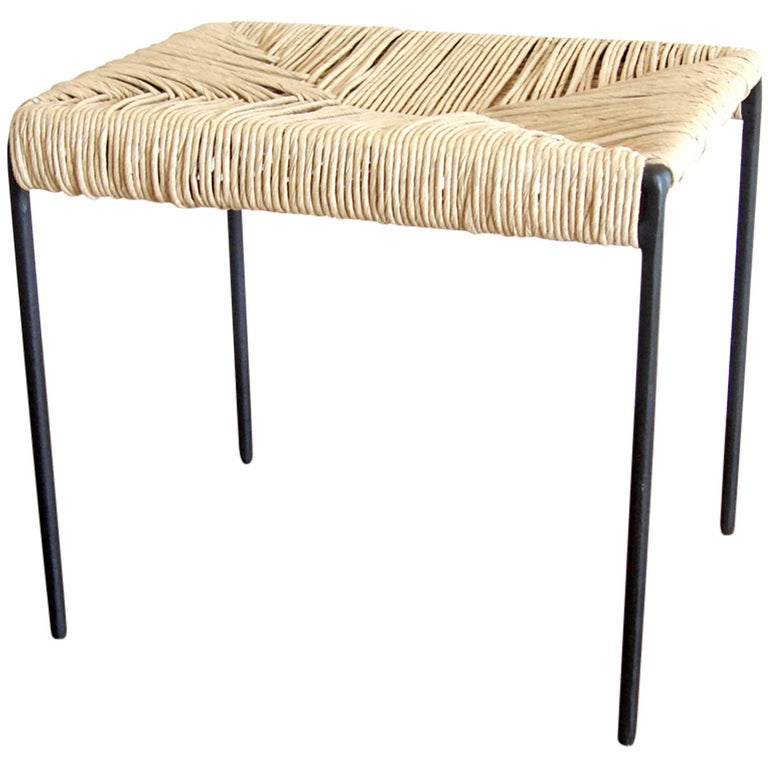 Americano woven cane and blackened steel ottoman stool For Sale