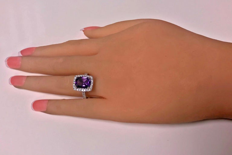 Amethyst and Diamond Ring, 14K white gold. The Ring claw set with a fine medium, moderately strong  purple rectangular cushion cut Amethyst, gauging approximately 10.00 x 8.00 x 5.00 mm, approximately 2.50 cts, the mount and shoulders set with a