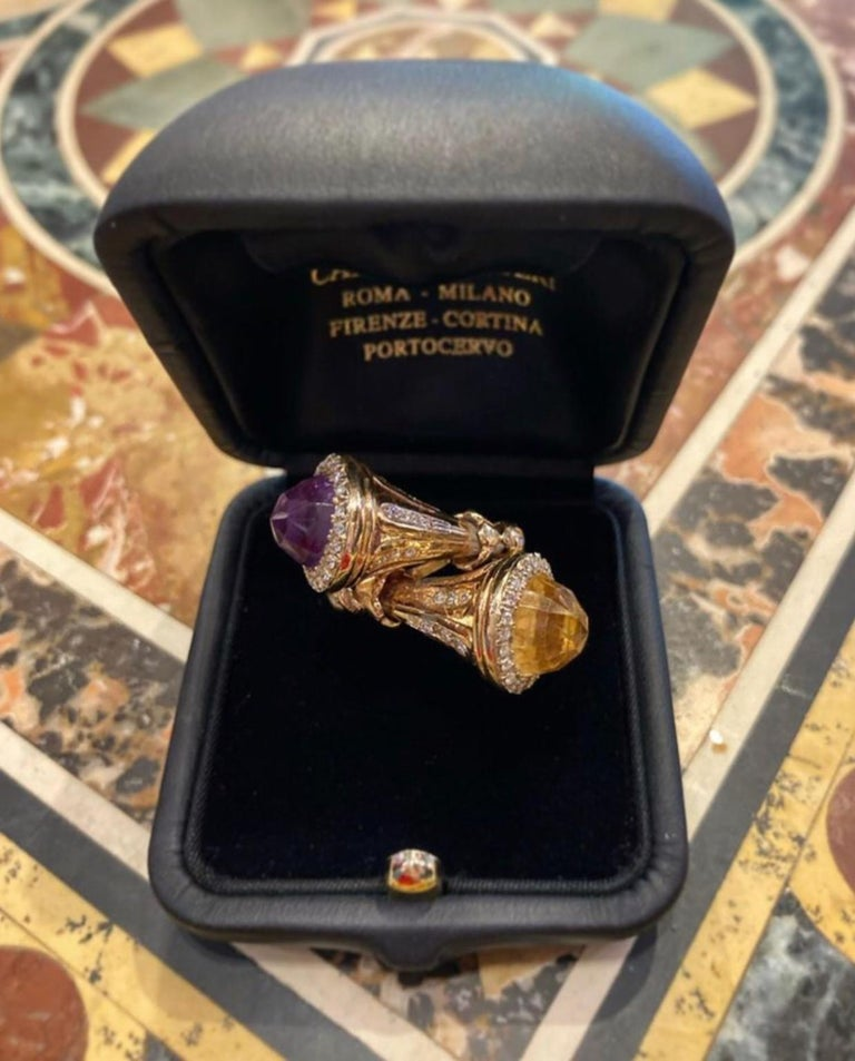 A fun vintage cocktail ring of bypass design featuring amethyst, citrine, and diamonds mounted in yellow gold. Circa 1970.