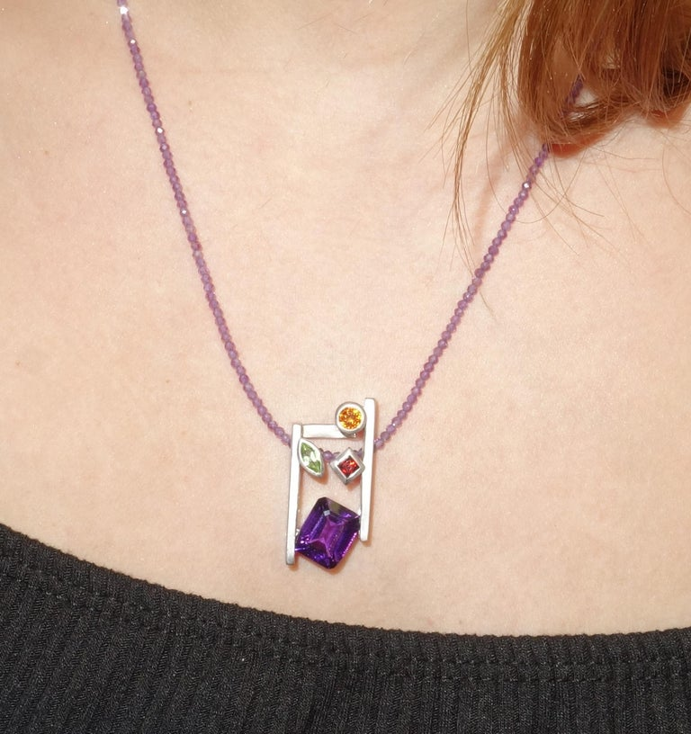 Beautiful and finely detailed Citrine, Amethyst, Peridot and Garnet Pendant set in Sterling Silver and suspended from a multi colored Tourmaline Necklace; approx. total weight of Gemstones: 4.73 Carat; The pendant is Hand crafted in Rhodium Sterling