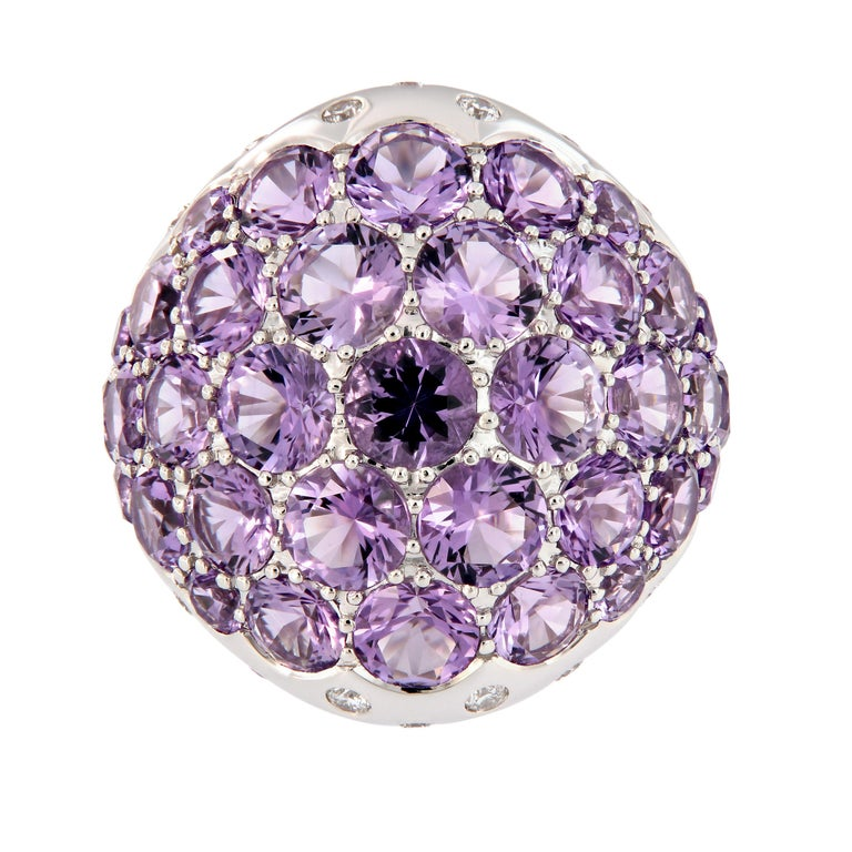 Make a stunning color statement with this 18k white gold dome ring. Ring features round light purple amethyst gemstones in a variety of sizes, accented with diamonds. Ring size is 6.25. Weighs 18.1 grams.  Amethyst 8.90 cttw Diamond 0.44 cttw