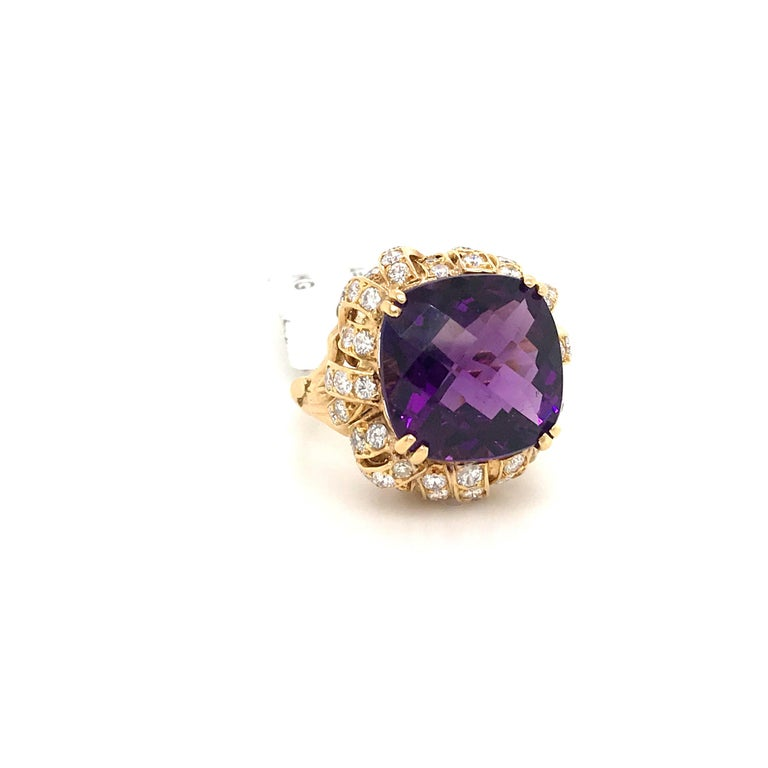18K Yellow gold ring featuring one cushion cut Amethyst weighing 20 carats flanked with diamond petal motif weighing 3 carats.  Color G Clartiy VS-SI  Ring is sizeable.   Amethyst: 14.91 mm x 15.19 mm