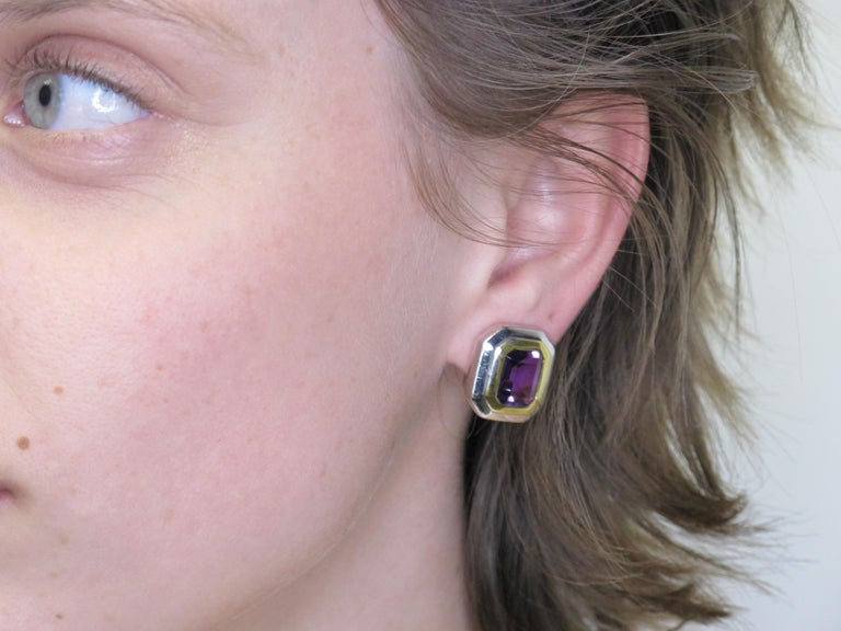 These earrings exude high polished sophistication. Made of two-toned 18k gold, they can be worn with either yellow or white gold. They have posts and French clips. The posts can easily be removed for the non-pierced wearer. Two deep,  concord-grape