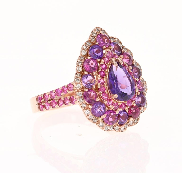 Amethyst, Purple Garnet Pink Sapphire and  Diamond Cocktail Ring!     This one of a kind piece has been carefully designed and curated by our in house designer!  This ring has a deep purple Pear Cut Amethyst that weighs 0.87 Carats and is