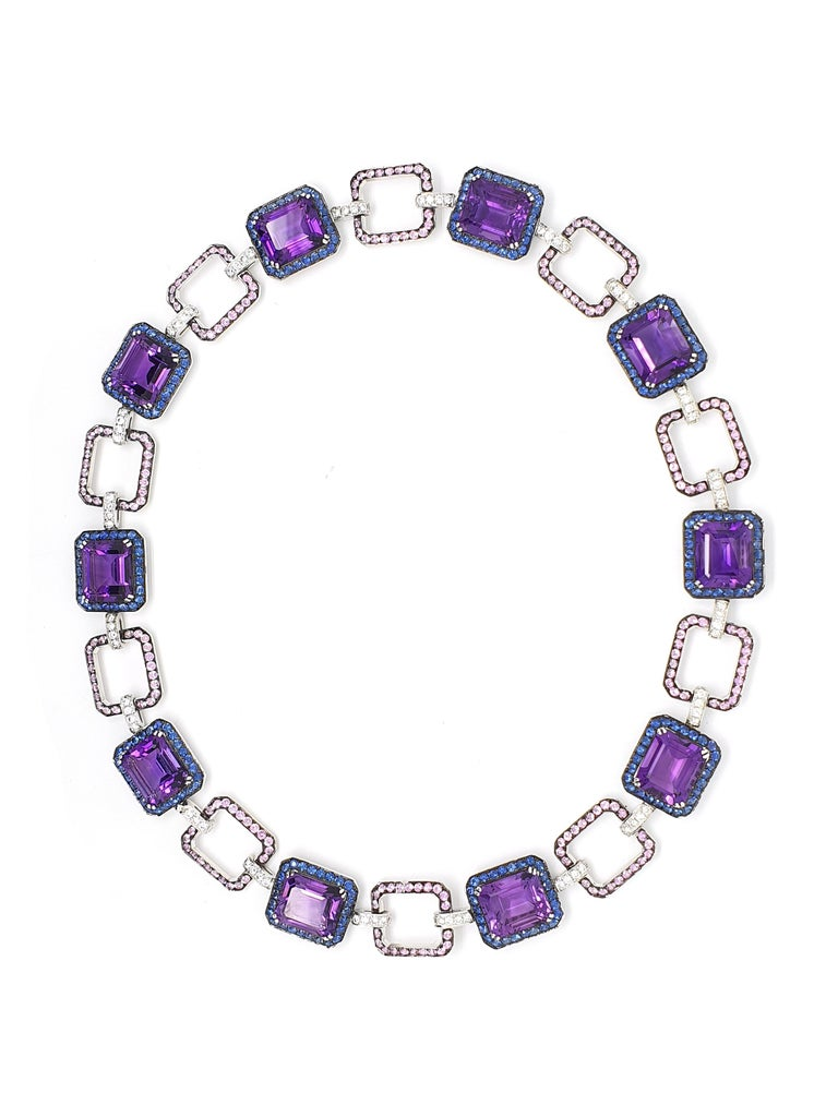 An 18K white gold necklace with 54.41ct, 8-angular sharpened Amethyst, 7.65ct, blue-lilac Korunden, 6.35ct pink 	Corunds, 1.95ct brilliantly sharpened diamonds colour W and clarity VVS. Rose gold weight 52.41 grams.