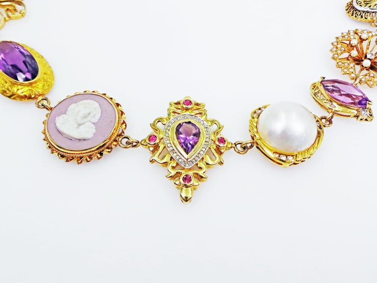One-of-a-kind, Bohemian necklace features a variety of rich, regal purple color tone gemstones and vintage jewelry components set in 14k yellow gold. Necklace is comprised of 17 beautiful pieces including: Australian Boulder Opal, White Diamond,