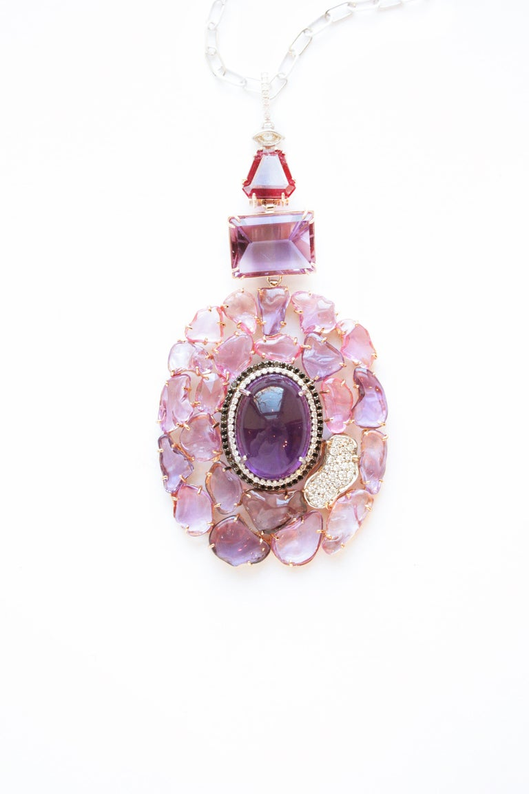 Joanie Necklace A sixteen-inch eighteen-karat white gold chain suspending a dramatic pendant composed of four motifs First motif - A marquise-shaped facetted white diamond Second motif - A 2.57 carat facetted fancy-cut spinel with a deep reddish