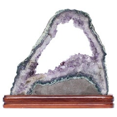 Amethyst Slice with a Baroque Pearl on a Polished Wood Base