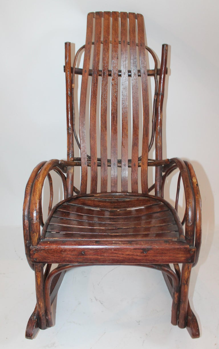 This vintage Amish child's rocking chair is in fine condition and was found in Lancaster County, Pennsylvania. The chair is in fine working order as well. This rocking chair has a very fine patina.