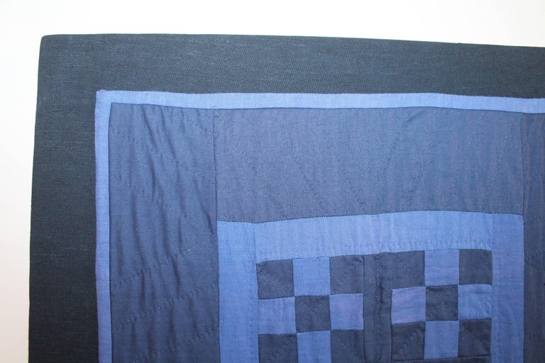 This most unusual deep royal blue back round with a robin egg blue chain in cotton. This Ohio Amish crib quilt is in fine condition and is mounted on a stretcher frame ready for hanging. Great piece of work and colors.