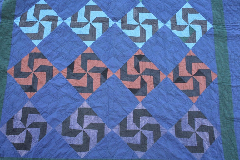 Amish fly foot quilt from Holmes County, Ohio with pastel colors. These colors are most unusual and colorful. The condition is very good and all line up perfectly.