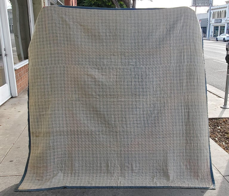 Amish all wool diamond in a square from Lancaster County, Pennsylvania in fine condition. It has fold marks in the center diamond in a square. This quilt is all wool. The early diamond are much harder to find then the later ones. The back is a fine