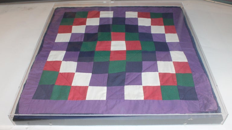 1940s made Amish doll quilts sewn on a stretcher with in plexi-glass and each quilt is in in pristine condition.