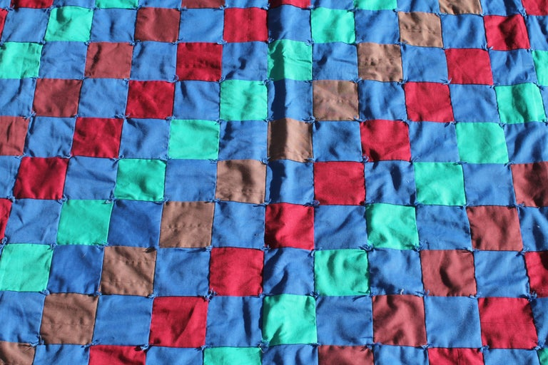 This amazing and colorful one patch quilt is tied and in mint condition. It is very large in size and has the same mint green back as in the front of the quilt.