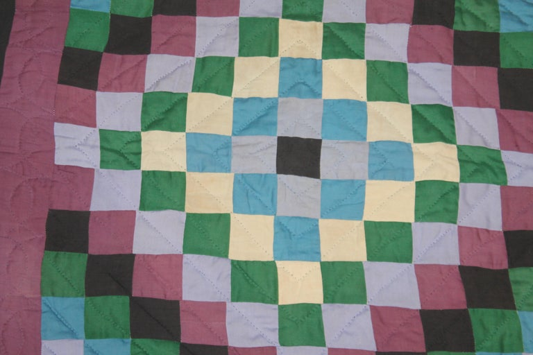 This Amish sunshine and shadow crib quilt is in good condition. It was found in Western Pennsylvania.