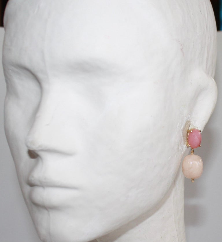 Set on vermeil, rose quartz stone and beveled cabochons dangles