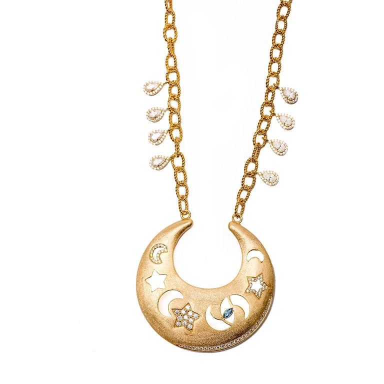 A gorgeous take on the sky, Sa'mma, the universal blanket the covers mankind and connects us all. Hand carved necklace with moons, stars and a protective eye that watches over us all. Sterling silver base with 18k gold plating, vermeil gold, with