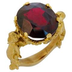 Amorini Ring in 18 Karat Yellow Gold with Garnet and White Diamonds