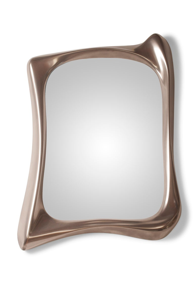 Unique style mirror with nickel finish.