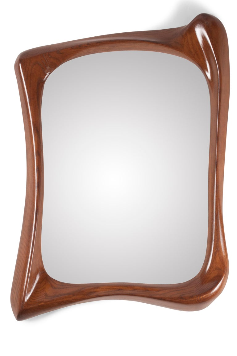 Unique style mirror with gold finish.