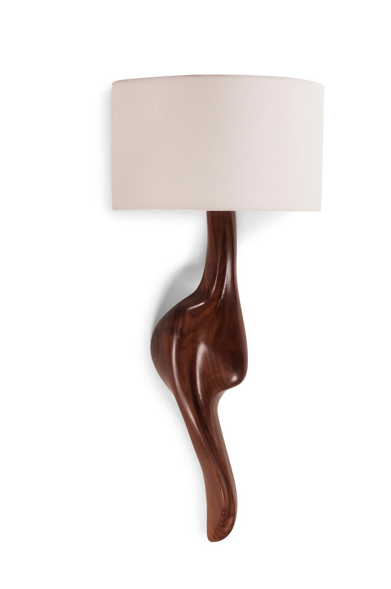 Oralee sconces is from solid walnut wood and stained natural.  Shade dimensions: 12