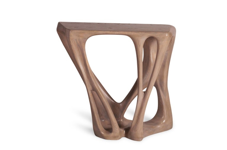 Petra console table is a unique organic shape console carved from solid ash wood. it is finished with gray oak stained. Available in custom sizes and finishes.