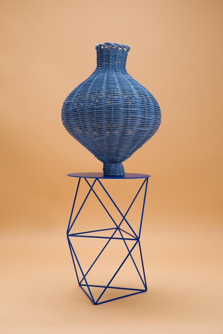 The Amphora Vase is hand dyed and woven with reed in our Chicago studio. Inspired by forms in ancient Greek ceramics, the material language of this vessel brings together the rich craft history of weaving with 3 dimensional form.  All of Studio