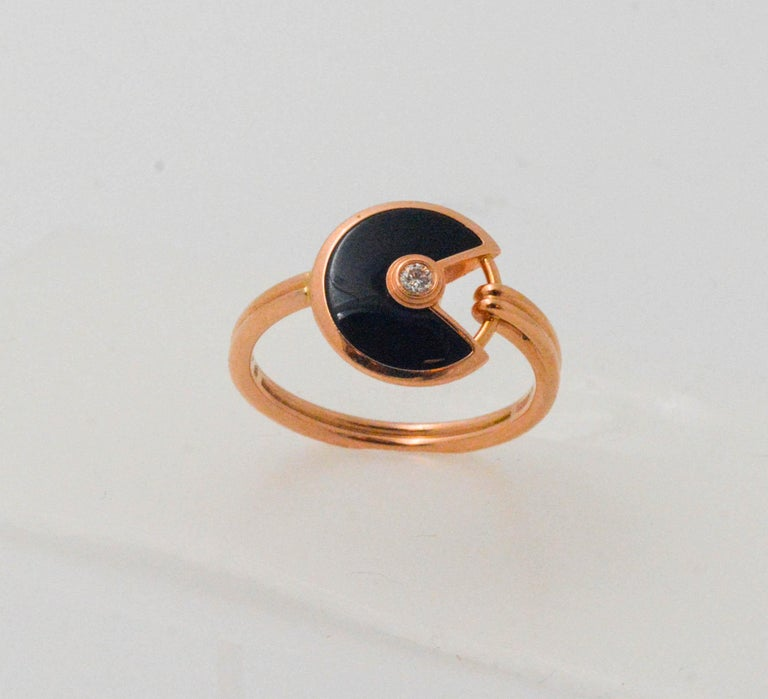 Amulette de Cartier black onyx and diamond ring was created